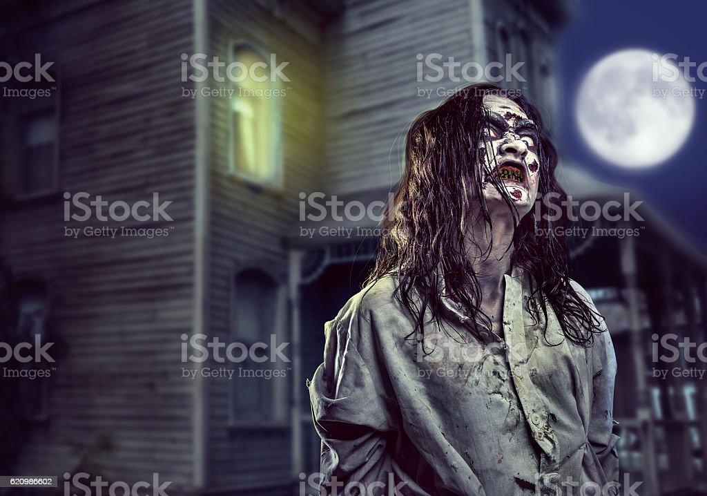 Horror zombie near the abandoned house. Halloween. foto royalty-free