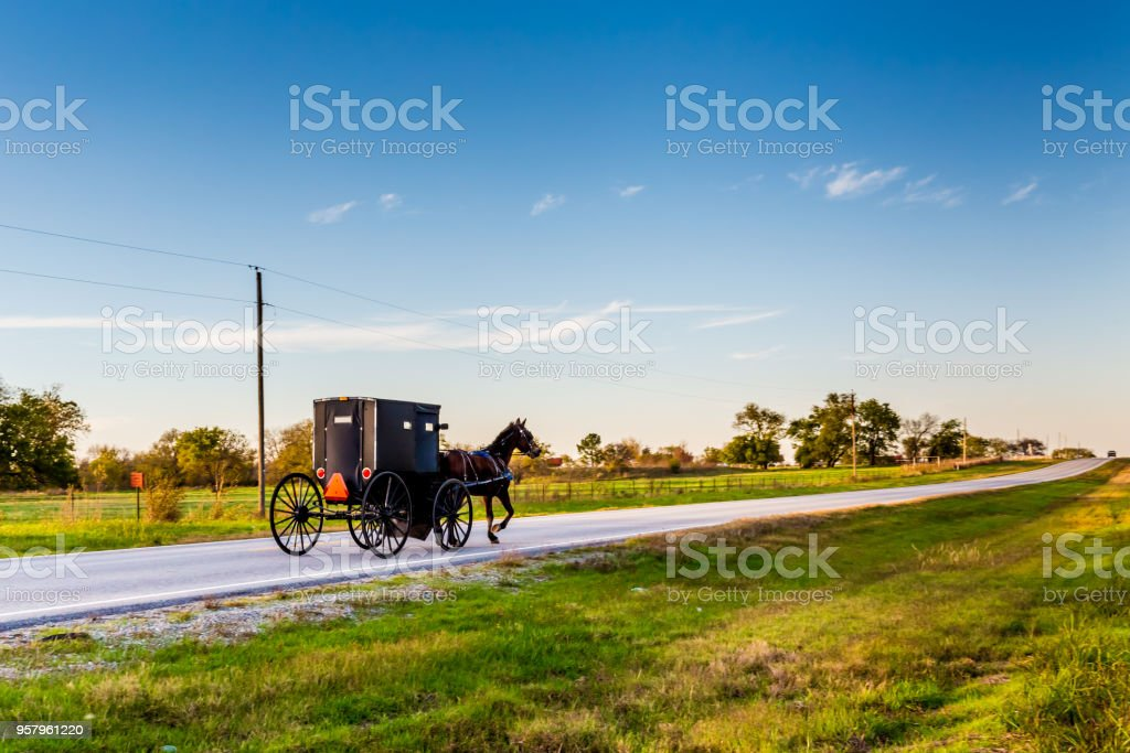 Horse and Carriage on Highway in Oklahoma stock photo