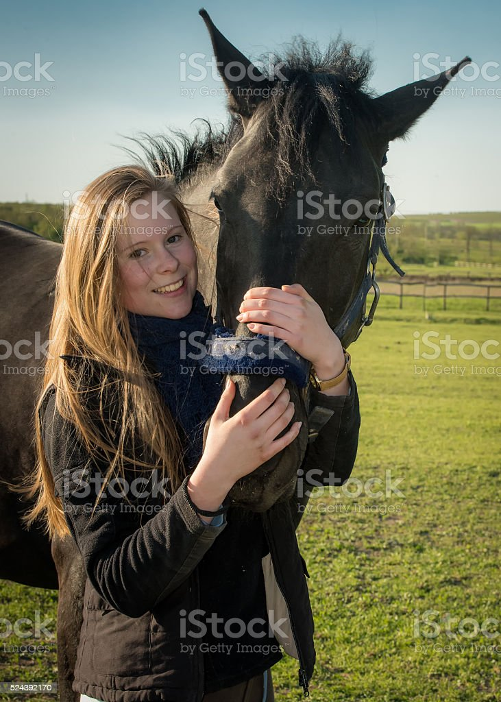 Horse and girl stock photo