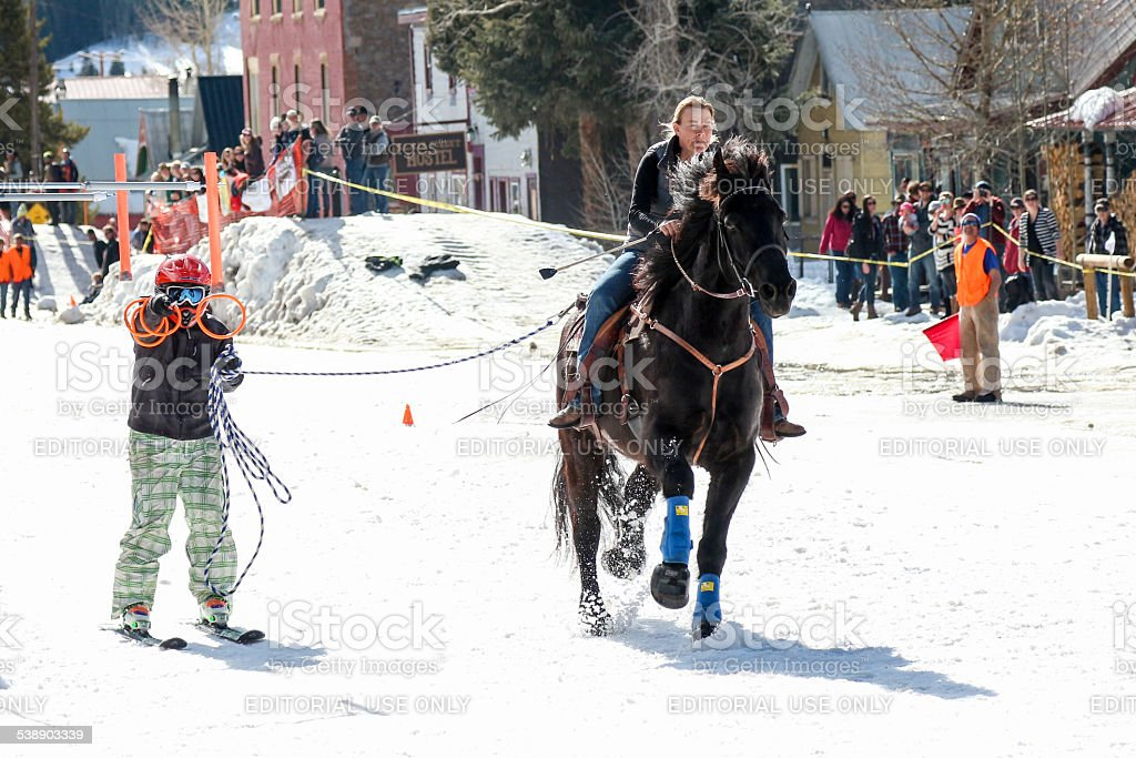 Horse and rider in the Silverton, Colorado skijoring competition stock photo