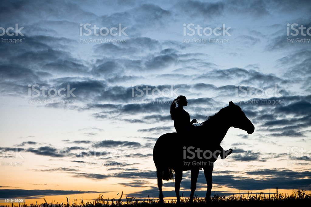 Horse And Woman At Sunset stock photo