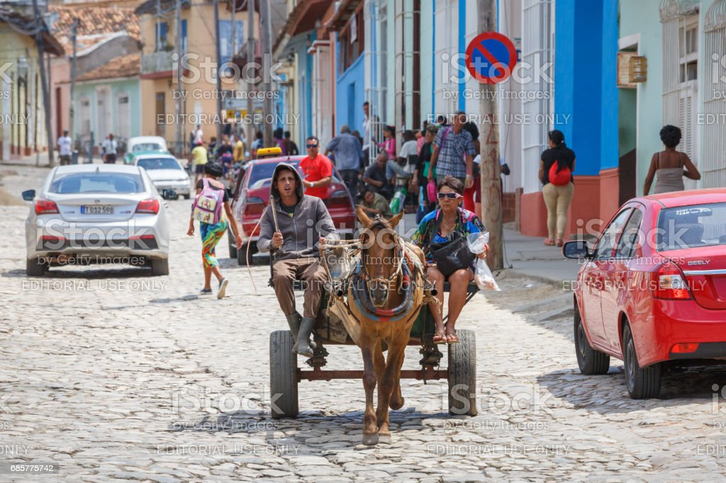 Horse carriage at streets with traditional buildings of Trinidad royalty-free stock photo