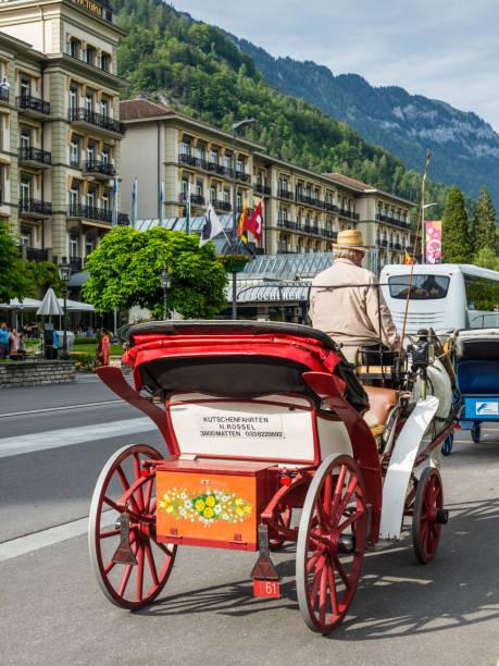 pferdekutsche in interlaken, schweiz - hotel bern stock-fotos und bilder