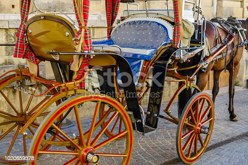 istock Horse carriage on the streets of the old town in Valletta, Capital city of Malta. 1020659378