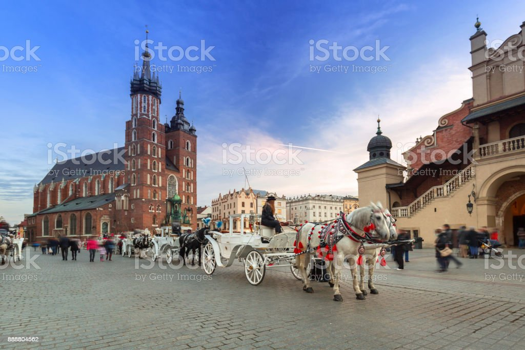 Horse carriages at the Main Square in Krakow stock photo