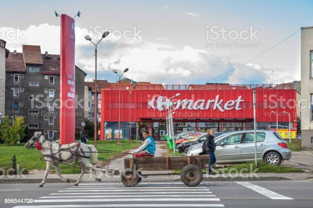Horse cart driven by people from roma community passing in front of a picture id856544702?b=1&k=6&m=856544702&s=612x612&h=pockwq6oh7bqflphqovkamurdqnqvyxp8mzgopb8 ay=
