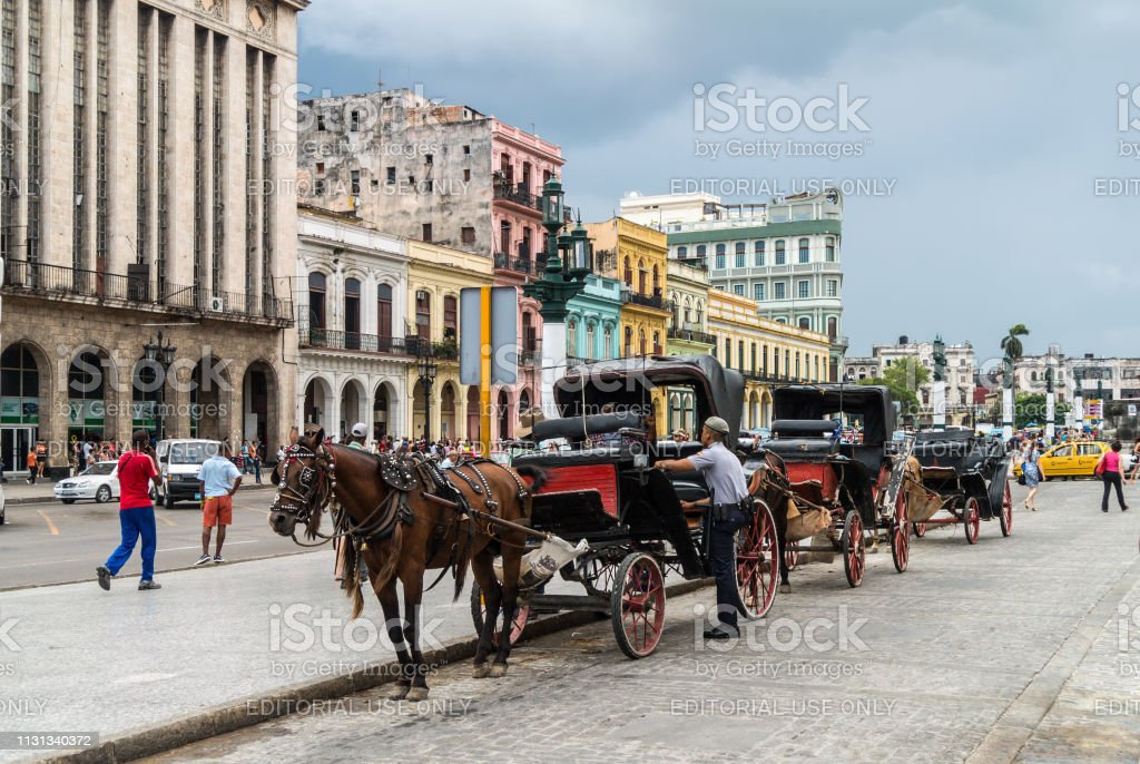 Horse carts waiting for tourist in Havana, Cuba stock photo
