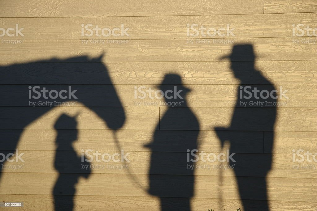 Horse, Cowgirls and Cowboy Shadows stock photo