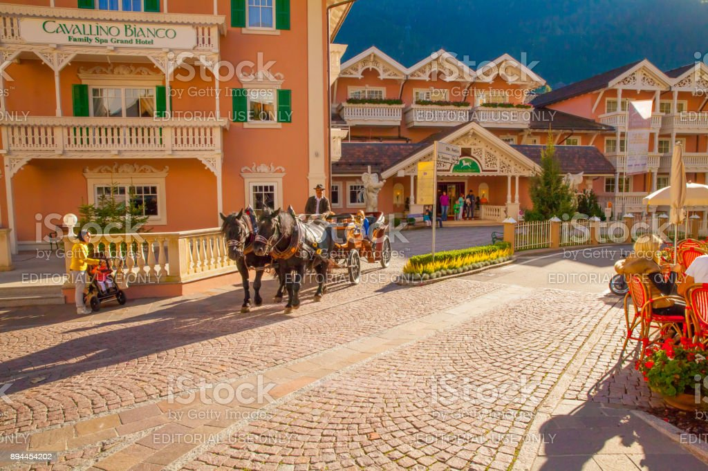 horse drawn carriage in the center of Ortisei stock photo