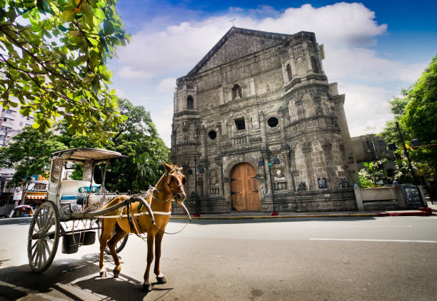 horse drawn carriage parking in front of malate church , manila philippines - philippines stock photos and pictures