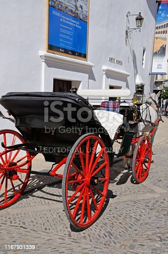 Horse drawn carriage parked outside the bullring, Ronda, Malaga Province, Andalucia, Spain, Europe.