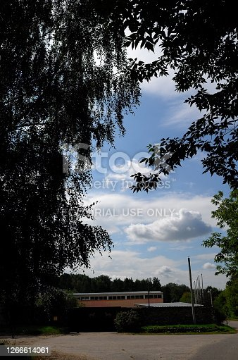 Moscow region, Russia - August 16, 2020: Horse farm area behind the trees