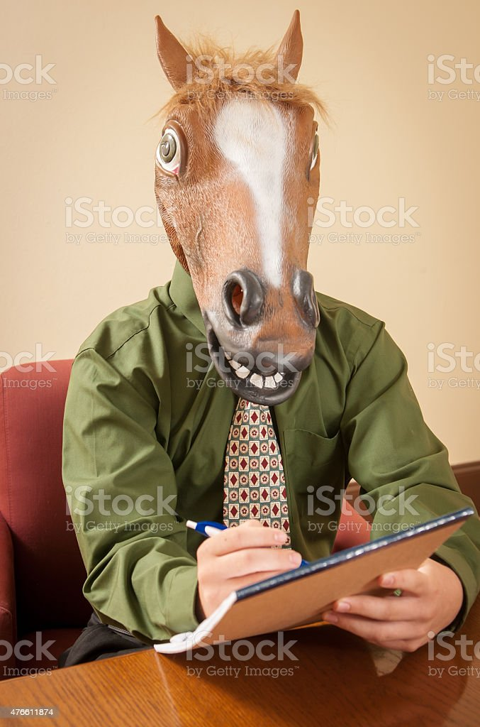 Horse head business man at conference room table stock photo