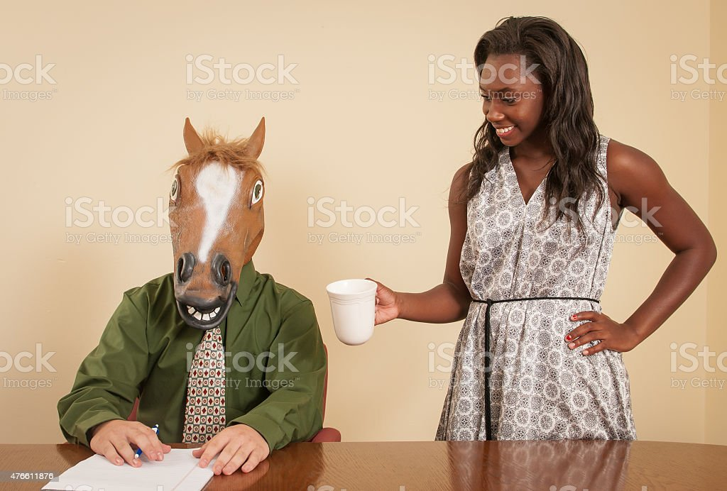 Horse head business man with secretary holding cup of coffee stock photo