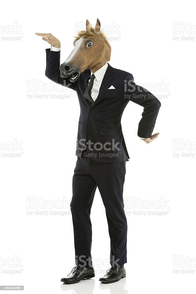 Horse head businessman dancing royalty-free stock photo