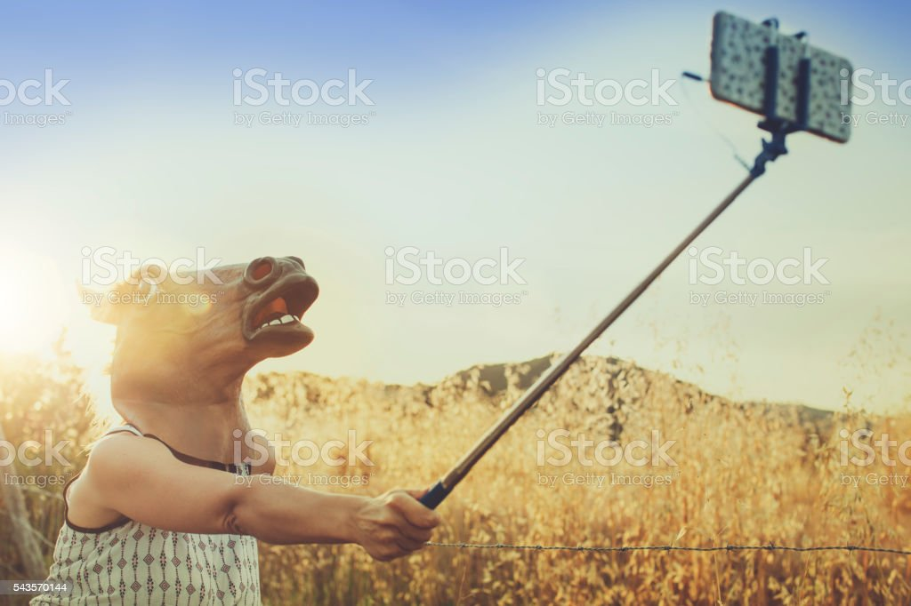 Horse head girl doing a selfie stock photo