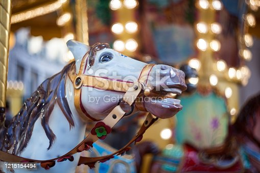 Horse head in the traditional fairground vintage carousel, Trieste