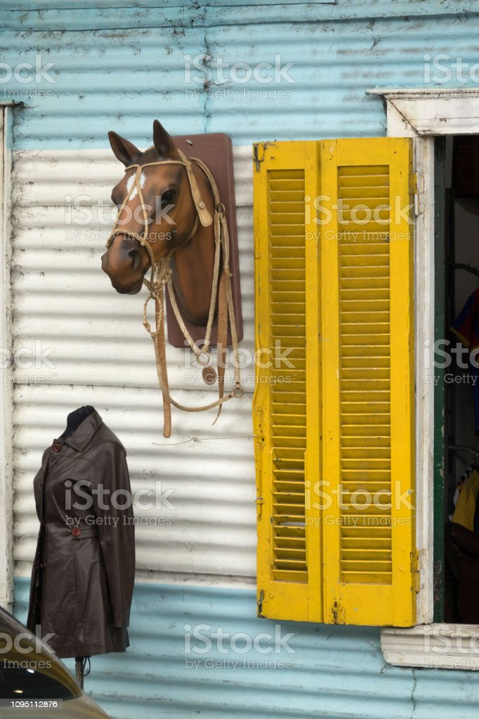 Horse head leather jacket colorful tenement shop Conventillo Historico de 1881 Buenos Aires Argentina stock photo