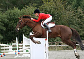 Girl partecipating in a show jumping competition in Norway