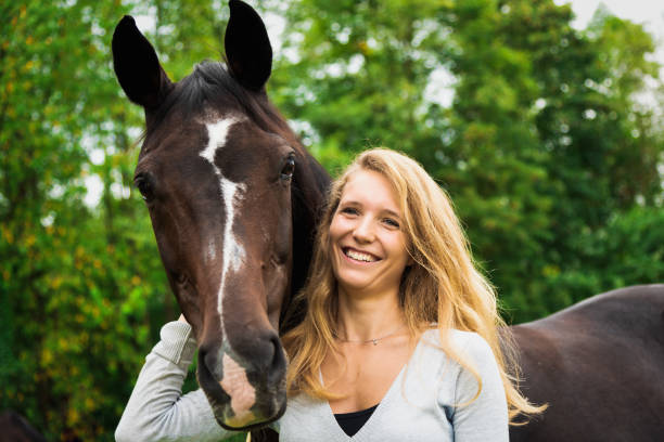 Horse Lovers Bright Smiling Young Woman Together with her Horse stock photo
