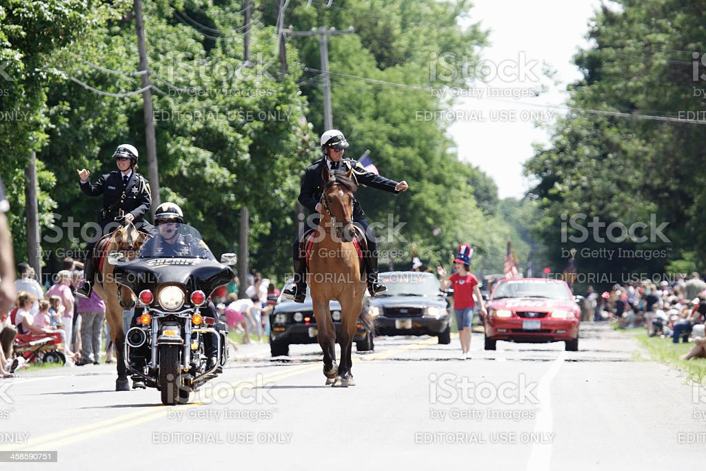 Horse Mounted Sheriffs Waving to Spectators at July 4th Parade stock photo