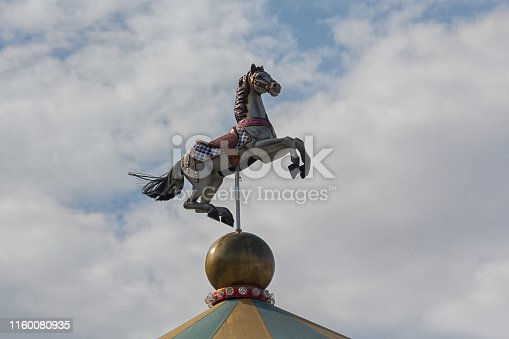 Horse over the dome of the carousel in the town square