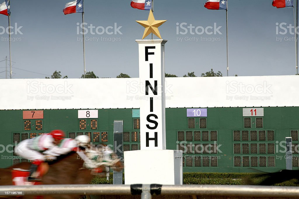Horse racing. Race track finish line. stock photo