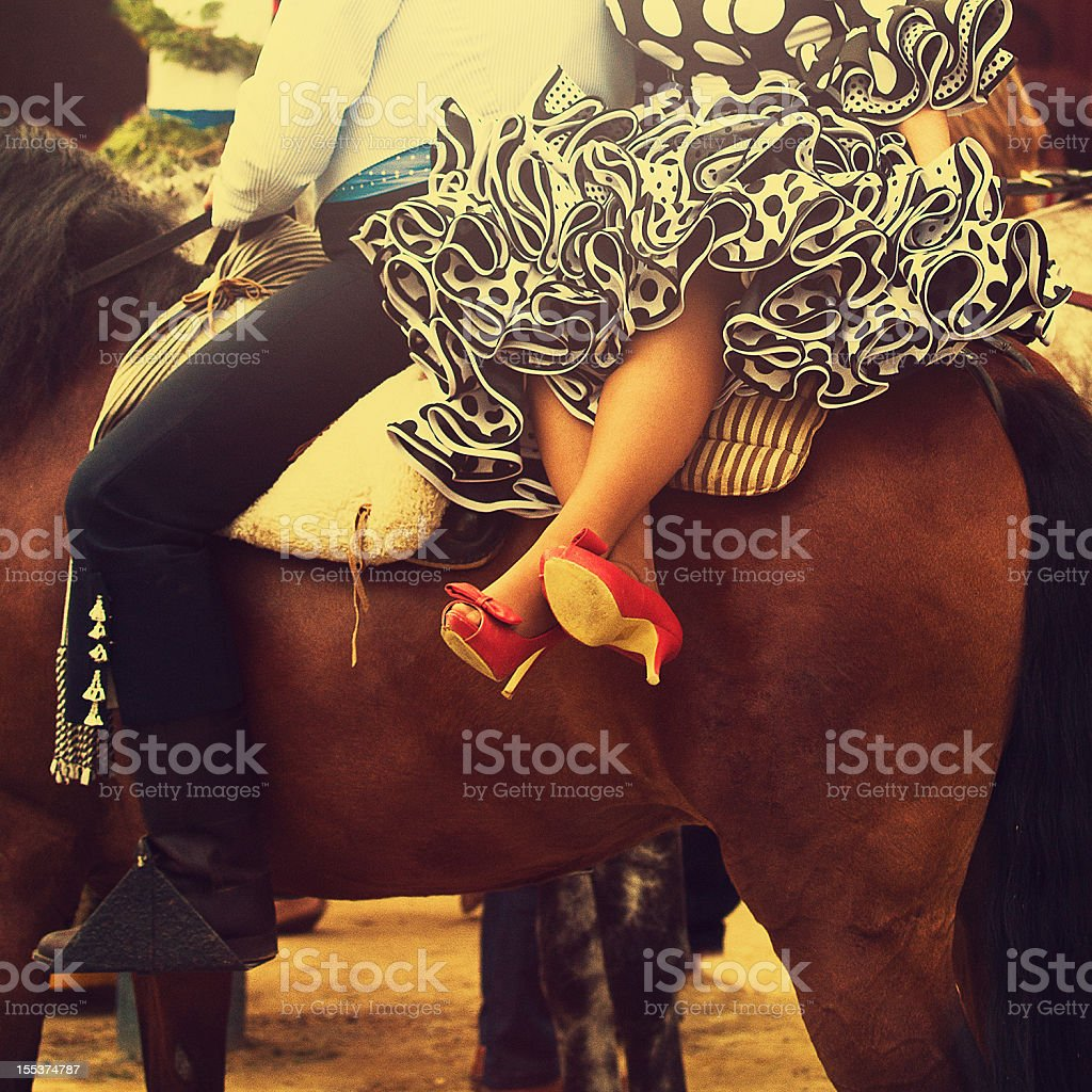 horse rider and woman in flamenco dress royalty-free stock photo