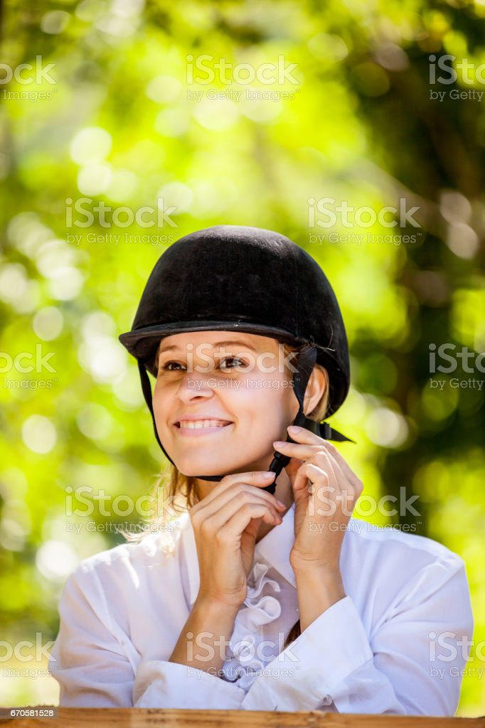 Horse Rider Shoud Wearing Helmet for Head Protection stock photo