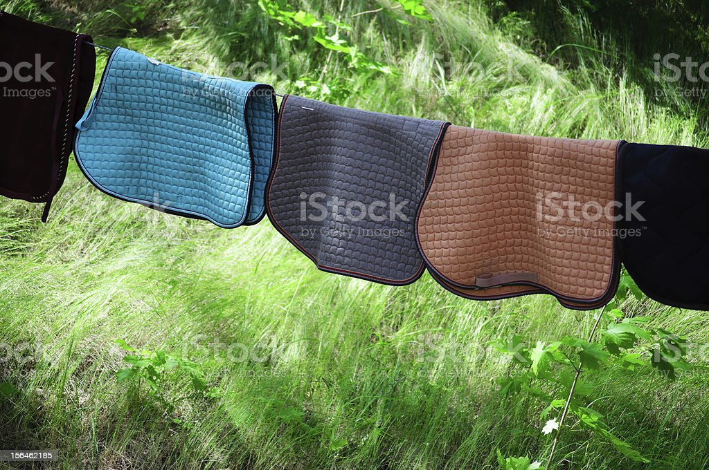 Horse saddle blankets drying outside. royalty-free stock photo