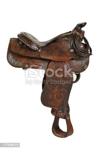 A beautiful vintage horse saddle isolated on a white background