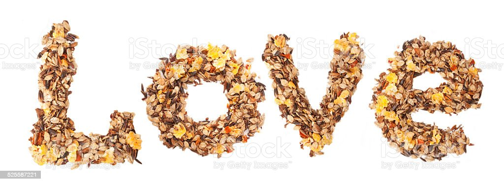 Horse sportive muesli as word LOVE. over white stock photo