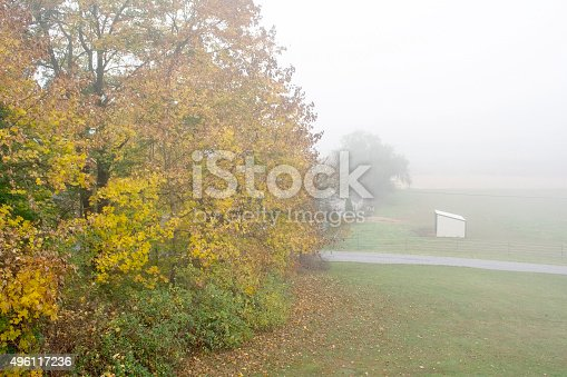 istock Horse Stable in a foggy morning mist 496117236
