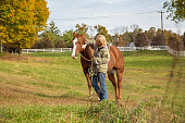 A woman takes her time working with her horse as her personal form of de-stressing.