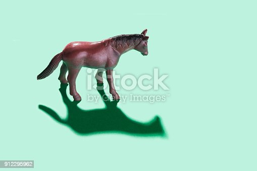 Horse toy on green  background