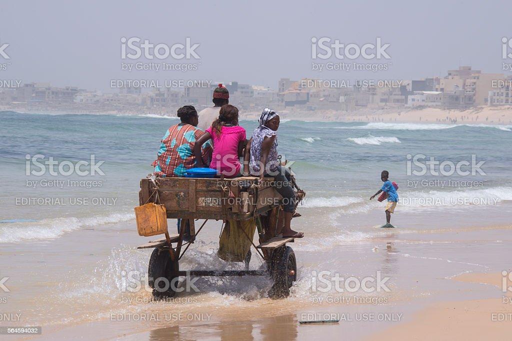 Horse wagon driving on the beach of Yoff , Senegal - foto de stock