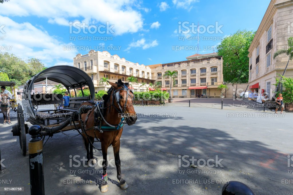 Horse with carriage waiting for tourists in Intramuros district stock photo