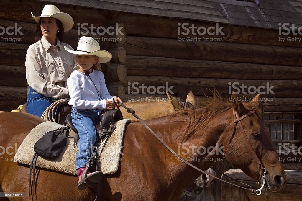 Horseback Mother and Daughter stock photo