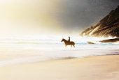 Vacation Lifestyles-Couple Horseback Riding at Sunset
