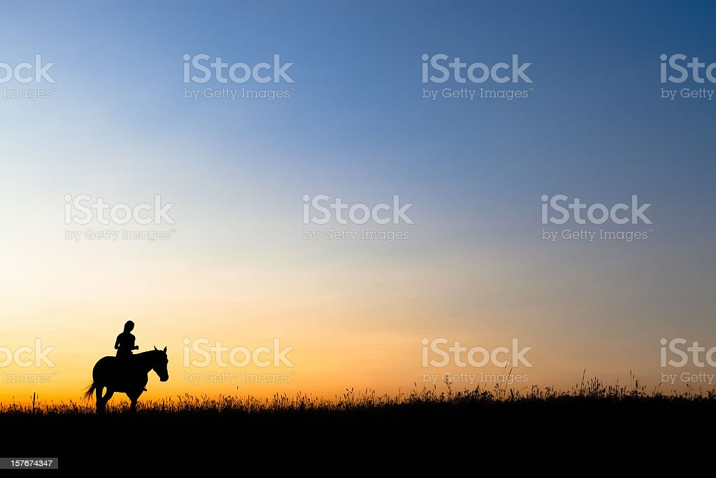 Horseback Riding At Sunset stock photo
