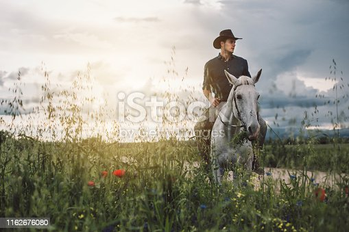 Man out in the wilds, riding a horse