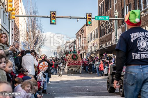Johnson City, Tennessee, USA - December 7, 2019: The horse-drawn Budweiser beer wagon, pulled by six Clydesdales, rolls down Main Street during the annual Christmas parade in Johnson City, Tennessee.