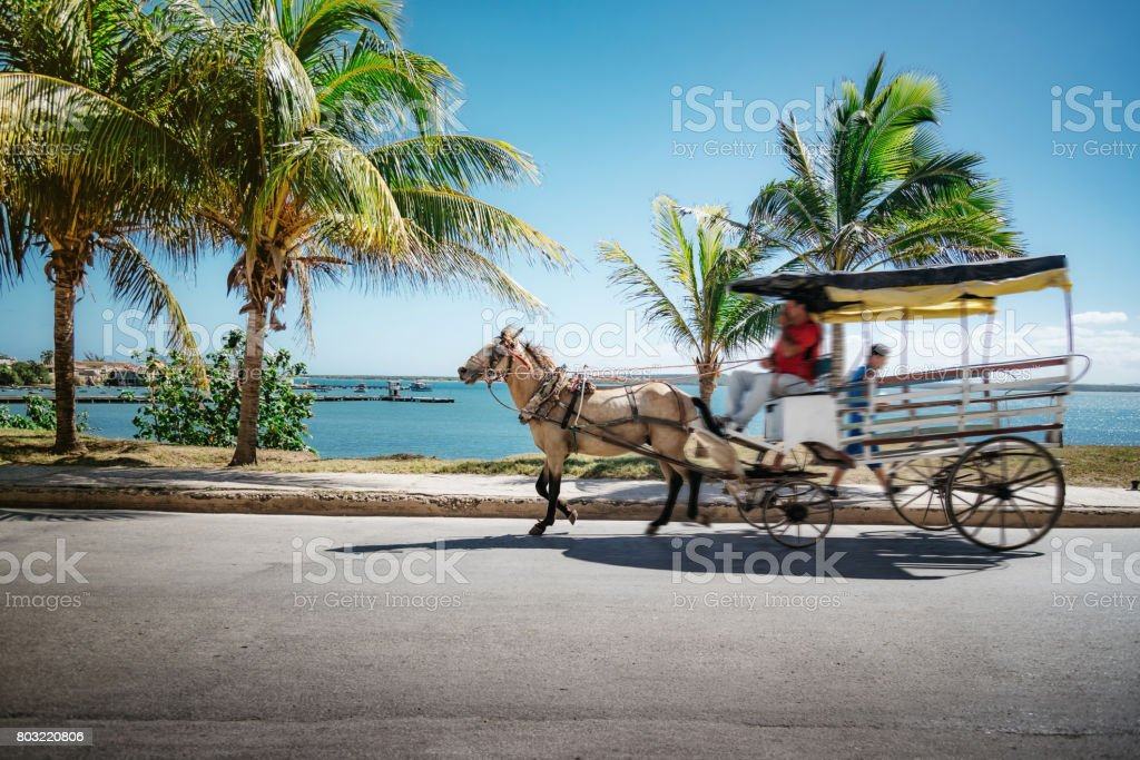 horse-drawn carriage on strees of Gibara in Cuba stock photo