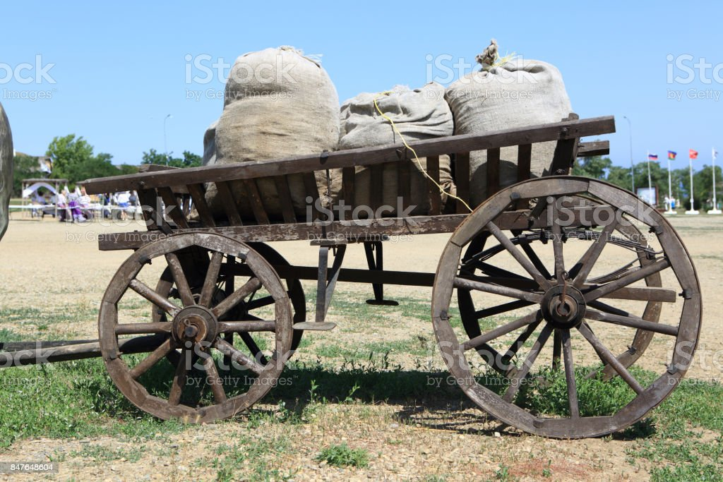 Horse-drawn carriage with bags of grain stock photo