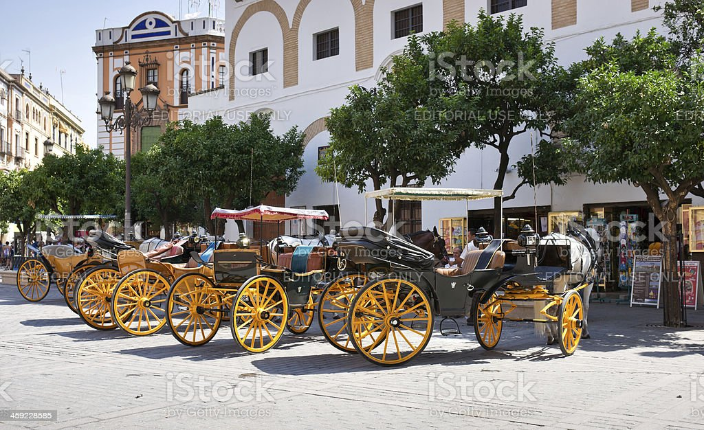 Horse-drawn Carriages on Plaza Virgen de los Reyes in Seville stock photo