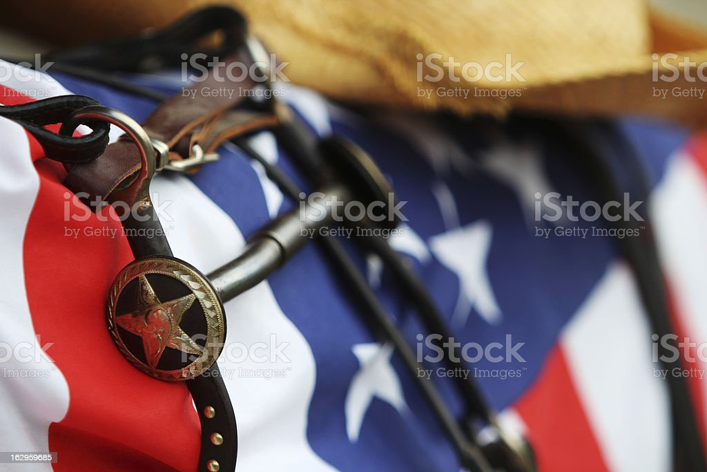 Horse-gear (texas-star) lying on USA flag stock photo