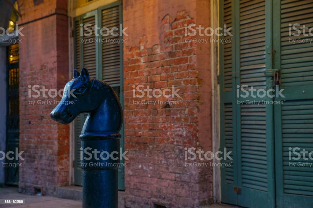 Horse-head hitching posts in the French Quarter of New Orleans, Louisiana stock photo
