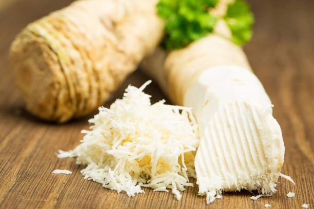 Horseradish on wooden board Food and drink: Horseradish on wooden board horseradish stock pictures, royalty-free photos & images