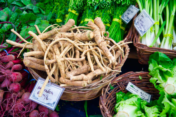 Horseradish roots and vegetables at the farmer's market farmer's market horseradish, beets, green garlic and lettuce horseradish stock pictures, royalty-free photos & images