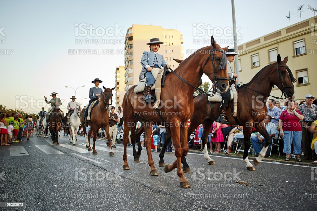 Horses and Riders Marching in Andalucian Spring Parade royalty-free stock photo